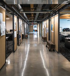 Sliding cork dividers and reclaimed timber trusses train line the hallways of Ankrom Moisan's headquarters in Portland.