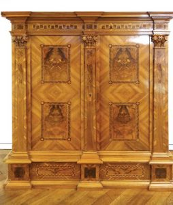 Figure 1: Wood veneer and marquetry casework built circa 1780.
