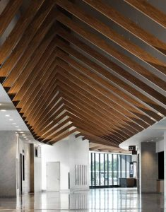 The changing peak heights of the beams create a wave-like effect to bring visual movement to the space.