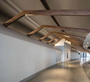 Wall and ceiling attachments, in conjunction with thin cables, were used to provide structural support for the beams at the Nassau Coliseum.