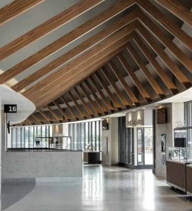 Lightweight extruded aluminum beams feature a wood look and guide visitors through the concourse around the interior bowl.