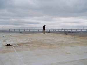 This image shows a failed single-ply roofing system. Note the elevated roof membrane hiding the fall protection anchor.