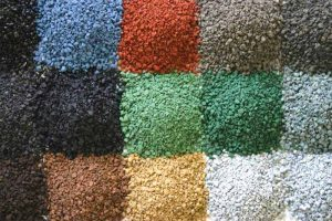 Asphalt shingle granules offer a diversity of colors and blends to suit many environments, climates, or terrains. Photo courtesy Asphalt Roofing Manufacturers Association