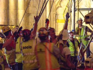 As St. Patrick's Cathedral needed to remain open to visitors during the day, a skilled installation team worked at night and into the early morning to successfully fix the glass wall.