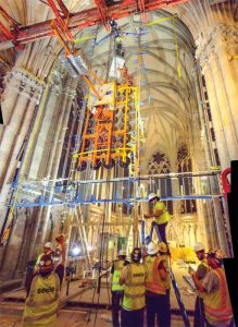 Installing the Lady Chapel enclosure's glass panels required constructing a hydraulic gantry to lift and manipulate the glass panels via a series of counter-weighted suction fittings.