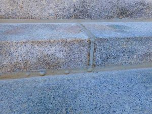 Bubbling observed at the face of light gray sealant between stair treads. Photos courtesy Wiss, Janney, Elstner Associates