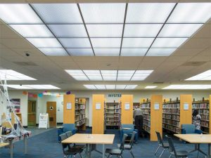 Figure 12: In addition to providing diffused overhead lighting, these luminous thermoformed ceiling panels create scale within the overall plane of the library's opaque mineral fiber ceiling. The ceiling grid members run continuously through both ceiling panel types in order to unify overall composition. Photo © Steve Miller