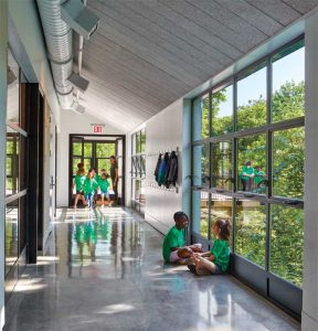 Life-cycle cost considerations led the design team to select steel windows rather than aluminum frames for the classroom building. Featuring thinner mullion and frame profiles, the steel windows were not only more durable but also compatible with the design intent.