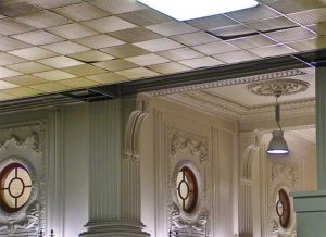 Figure 13: A suspended ceiling was a practical way to install new lighting and air distribution in Seattle's King Street Station in 1967. Tastes had changed and the suspended ceiling was removed to expose the ornamental ceiling in 2010. The panels that are not seated properly were probably raised to provide access to the above-ceiling cavity, but were difficult to manipulate and reposition correctly due to their stiffness. Photo © CC BY-SA 1.0 by Bachcell