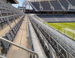 A safe standing system with integrated seating has been utilized at the Los Angeles Football Club's (LAFC's) Banc of California Stadium. Photo courtesy Trex Commercial Products