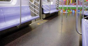 Directional flooring inlays are seamlessly integrated into the rubber flooring for added durability and resilience.