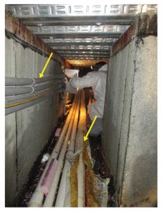 Figure 5: Horizontal utility lines with minimal clearance above and adjacent to waterproofing in interstitial space.