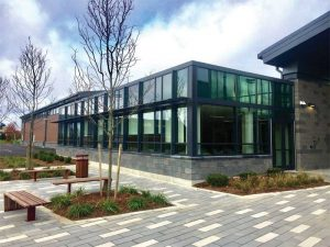 A school cafeteria's exterior appearance provides no hints that the glazing system employed in this project actually has security glass.