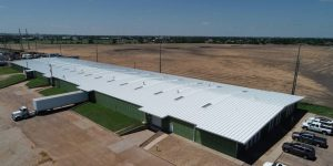 The versatility of a symmetrical standing seam metal roofing system helped Northwest Distributors deal with damaged metal roofing at their warehouse in Hays, Kanas. Photo courtesy Roofmasters