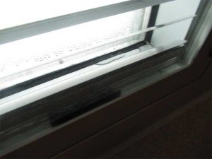 Close-up view of ice accumulation on a monolithic glass pane when the exterior temperature was –29 C (–20 F). Photo courtesy WJE
