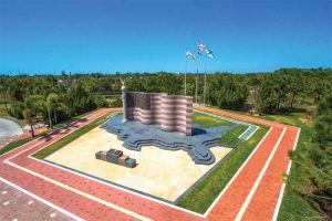 Mesabi Black pavers and treads create a base shaped as the United States, and Kasota Valley Limestone pavers surround the front of the base of the Collier County Freedom Memorial in Naples, Florida. Domestic fabrication and material was specified for this project. Photo © Albert Mountcastle