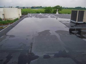 Figure 1: Ponded water can be observed between the outer perimeter of the structure and the rooftop unit (RTU). This ponded water will remain until evaporation takes place. Images courtesy Alliance Roof Consultants, Inc.