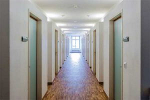 A common location for 20-minute fire door assemblies is a residential corridor leading to dwelling or sleeping units.