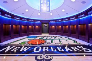 The new men's basketball locker room at the University of Kentucky (UKY), Lexington, Kentucky, is in the shape of a basketball. The challenge was to get the wooden locker units to meet at the top so as to achieve the desired circle shape.