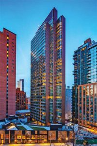To create an industrial metallic look, more than 8574 m2 (92,000 sf) of the aluminum wall panel system on the south side of the Forge, a luxury residential tower in New York City, was finished in a proprietary copper color anodize and painted an additional 446 m2 (4800 sf) in black iron. Photo © Arch Photo, Inc./Eduard Hueber. Photo courtesy Linetec