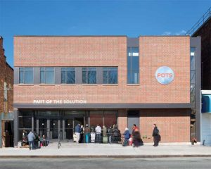 Spacesmith's design for Part of the Solution (POTS) office in Bronx, New York, includes a full-service kitchen and dining area, food pantry, counselling offices, a clothing exchange, showers, a barber shop, and medical suites.