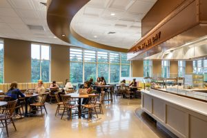 The new dining commons at Mount Holyoke College in South Hadley, Massachusetts, combines three styles of thermoformed ceiling panels as well as a type of mineral fiber panel to create visual scale and flow through the large hall. Photo © Chun Y Lai Photography