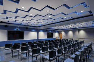At the National Oceanic and Atmospheric Administration's (NOAA) National Logistics & Reconditioning Center in Grandview, Missouri, metal ceiling panels installed diagonally in a herring bone pattern create a signature space. Photo courtesy Armstrong Ceiling & Wall Solutions