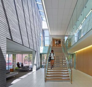 The Branksome Hall Athletics and Wellness Centre in Toronto, Canada, provides a direct connection to its surroundings with abundant daylighting and a natural palette of materials, finishes, and textiles.