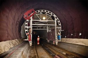 The world's longest tunnel, the Gotthard Base Tunnel located  in Switzerland, is a double-shell underpass with a combination  of waterproofing system and drainage layer between the shotcrete outer shell and the concrete inner shell. Images courtesy Dörken Systems