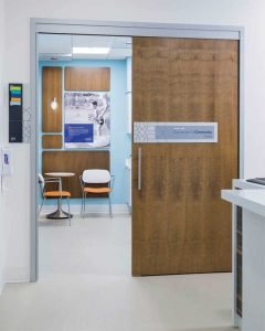 Barn-style commercial doors allow patients and staff to navigate easily between spaces without losing critical room.