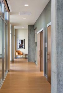 Interior sliding doors impact less space through door operations, improving wayfinding and usability in tight or enclosed areas.