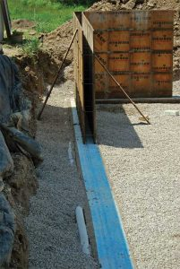 Installation of a footing barrier.