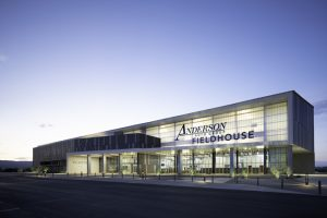 The Anderson Auto Group Fieldhouse, Bullhead City, Arizona, utilized a translucent wall system to create a gem-like appearance and enhance daylight, comfort, and durability. Photo courtesy Matt Johnson, Winquist Photography