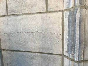 Typical glaze crazing, which compromises water penetration resistance. Cracking indicates where stress exists, often due to corrosion of anchorage. On top, an inappropriate repair is failing, as the underlying deterioration mechanism was unaddressed, and the incorrect material was used. Photo courtesy Hoffmann Architects, Inc.