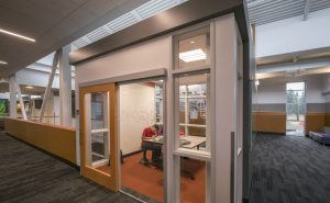 The North Creek High School, Bothell, Washington, used single leaf sliding doors to support the collaborative culture at the school, provide space savings, daylighting, and sound attenuation. Photo © Chris Eden/edenphotography.us. Photo courtesy AD Systems
