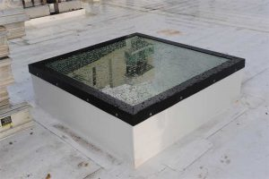 Water infiltration and condensation must be drained or weeped away from the edges of the glass to prevent detrimental freezing of the water, damaging effects of moisture on the edge seals of insulating glass, or possible debonding of interlayer material in the laminated glass. Photo courtesy Vtech Skylights