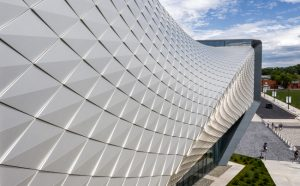 The museum façade consists of over 9000 folded anodized, diamond-shaped aluminum panels.