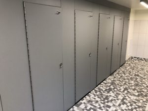 Madrona Hall at the University of Washington, Seattle, utilized high-density polyethylene (HDPE) partitions to create privacy for its co-gender restroom design. Photo courtesy Scranton Products