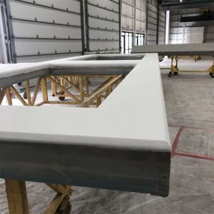 All finishes may be applied in the shop, including sheathing, insulation, barrier system, and final painting. Photo courtesy South Valley Prefab and the Association of the Wall and Ceiling Industry