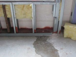 Water leakage during the initial performance verification testing of an installed window assembly. Leakage was attributed to omission  of a critical seal. Photo courtesy WJE