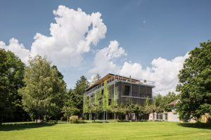 Snøhetta completes a lush and open timber office for ASI Reisen in Natters, Austria. Photo © Christian Flatscher