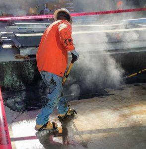 Installation of hot rubberized asphalt membrane.
