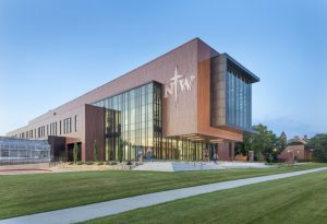 The DeWitt Family Science Center, Orange City, Iowa, used coated metal for its exterior to match the brick buildings on the Northwestern College campus and add a modern touch. Photo courtesy Sherwin-Williams