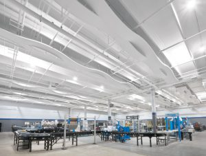 Atlantic Packaging, Charlotte, North Carolina, adds aesthetics and acoustics to its remodeled solution center with an undulating ceiling system. Photo courtesy Armstrong Ceiling Solutions
