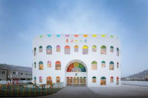"The shape, white exterior, and rainbow-hued arches of laminated glass with PVB color interlayers make Kaleidoscope in Tianshui City, China, the brightest ""birthday cake"" ever. Photo © CreatAR Images"