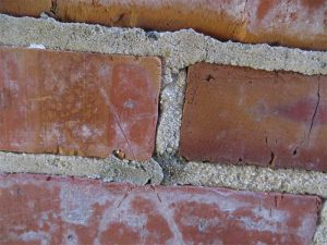 Although the existing pointing mortar is cracked and weathered, samples can be obtained to determine its composition. (Some non-matching repointing mortar is also visible in this photo.) Photos © David S. Patterson, AIA