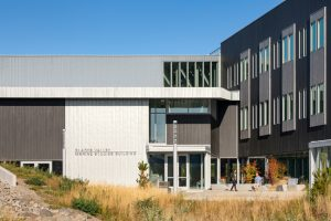 Oregon State University's new marine science building in Newport, Oregon, creates a modern architectural design with natural pre-patina blue-gray zinc roofing and wall cladding. Photo © Josh Partee. Photo courtesy RHEINZINK