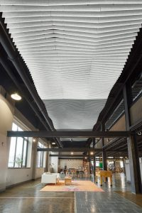The Stone Independent School in Lancaster, Pennsylvania, added a trio of ceiling treatments to improve the acoustic environment in their new location which used to be a manufacturing facility. Photos courtesy Armstrong Ceiling Solutions