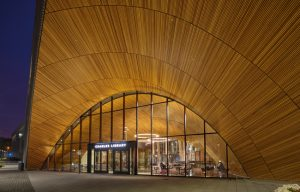 At the Charles Library, located at Temple University's main campus in Philadelphia, Pennsylvania, the design team used western red cedar to impart a warm, inviting, natural look. Photo courtesy Armstrong Ceiling & Wall Solutions
