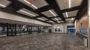 The Noble Public School, Oklahoma, used aluminum ceiling panels on its fine arts auditorium and gymnasium to meet the design, budget, and acoustical goals of the multipurpose space. Photo © Simon Hurst Photography. Photo courtesy of Rockfon